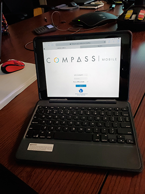 computer screen with COMPASS website