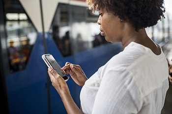 Woman looking at mobile device