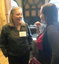 Anita smiling and talking